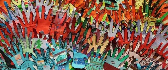 Collage of paper hands from harmony day.